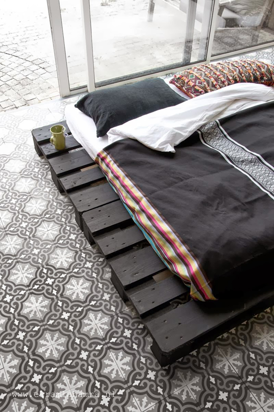 Patterned floor tiles and black palette bed. Photo via El Ramla Hamra.