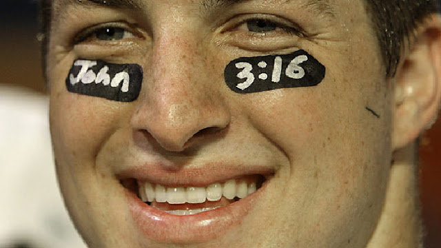 Taken a vow of virginity ... NFL quarterback Tim Tebow shows his Christian beliefs with the bible text John 3:16.