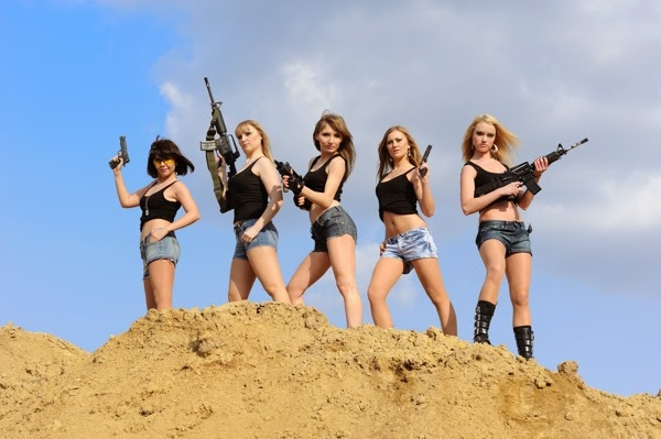 Ladies on a sand bank with fake guns