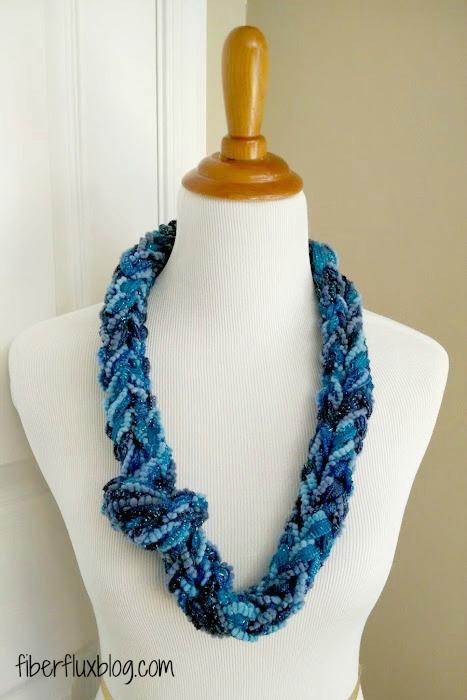 Finger Knitting Uses : How to make a finger knit sparkle cowl fiber flux