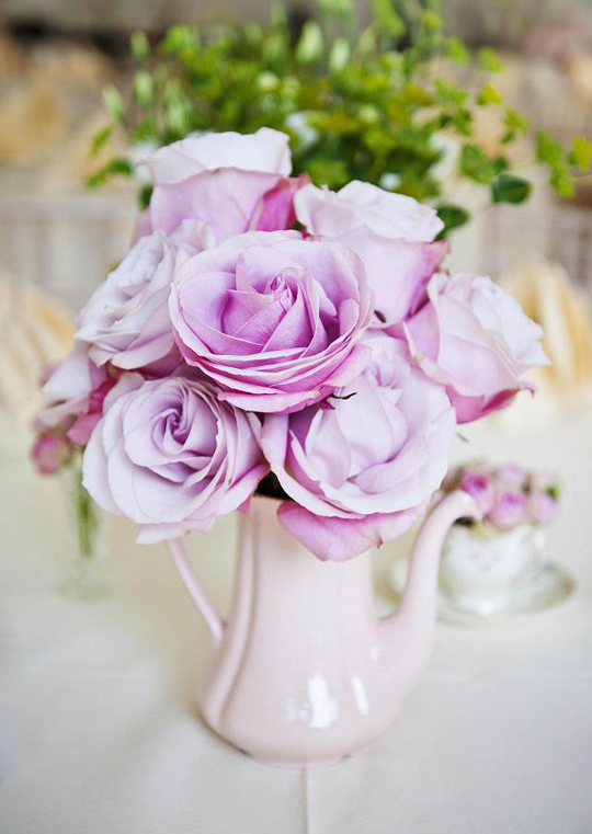 large pink roses in a vintage pink coffee pot