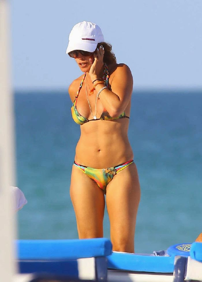 Cristy Rice shows off a Rainbow Bikini as she enjoys the Miami sunshine‭