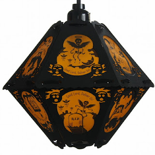 Good Lord Deliver Us, cries the poem of The Cornish Litany on this orange and black vintage style paper hanging pendant lantern