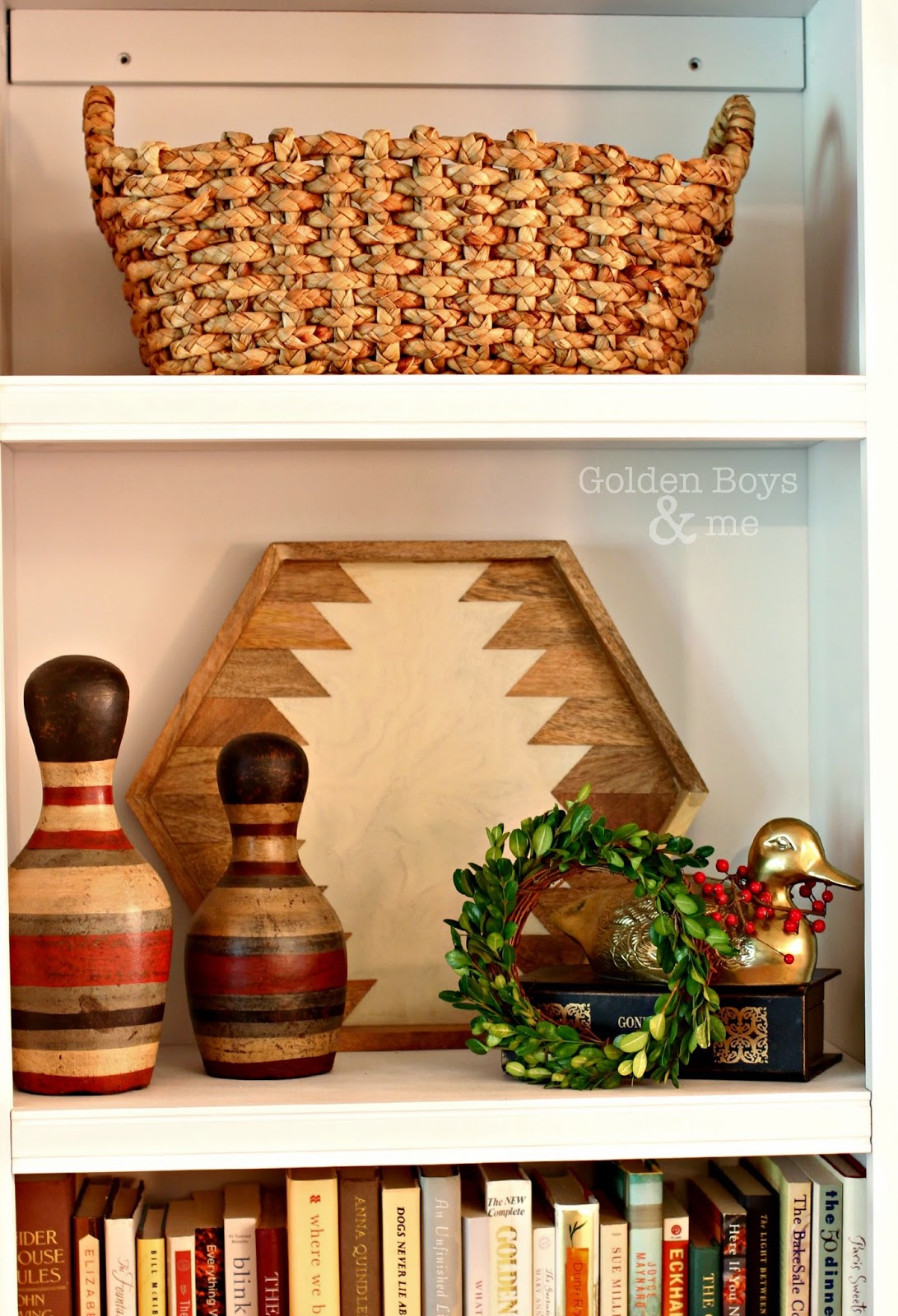 DIY small boxwood wreath on bookshelf with basket, bowling pins and Nate Berkus tray-www.goldenboysandme.com