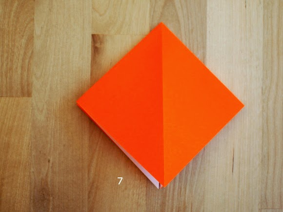 step 7 showing how to fold an origami pumpkin