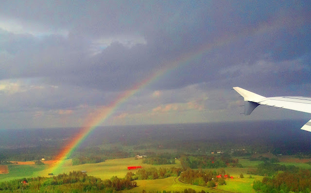 Rainbow from an airplane window