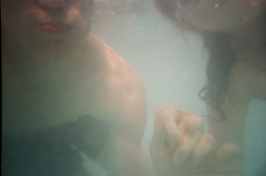 Underwater Photograph with Reusable Lomo Camera Couple Holding Hands