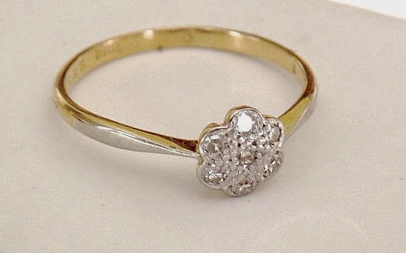 https://www.etsy.com/listing/193935477/vintage-18k-diamond-flower-cluster-ring?ref=favs_view_4
