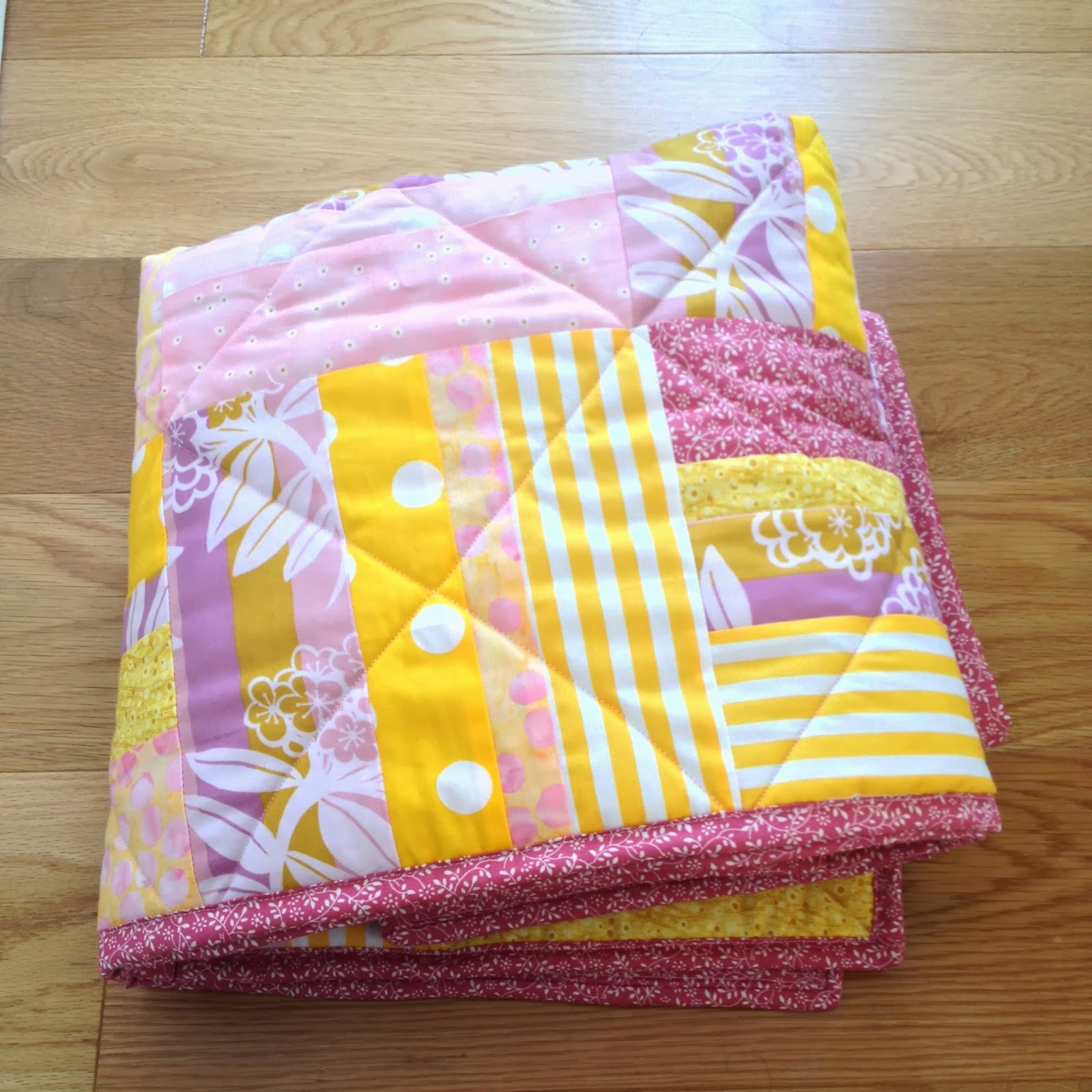 http://creatingincolour.blogspot.co.uk/2013/10/simple-stripes-cot-quilt.htm