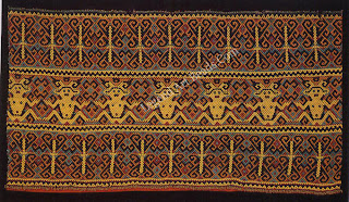 A woven bead-work skirt from the Maloh tribe in Kalimantan. The beads have been woven into solid panels, although the Ma/oh may not have actually practiced the weaving of cloth. The ceremonial costume of the Maloh consists of a highly decorated short skirt, jacket, and headcloth. Maloh beaded skirts and jackets are decorated with motifs only they can identify. The geometric shapes represent familiar, objects from the Maloh natural world translated into designs that were derived from Islamic motifs.