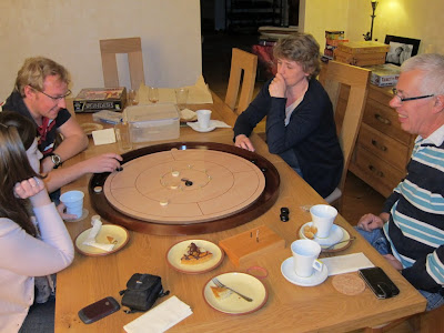 Crokinole - The game being played by some of our Monday night group