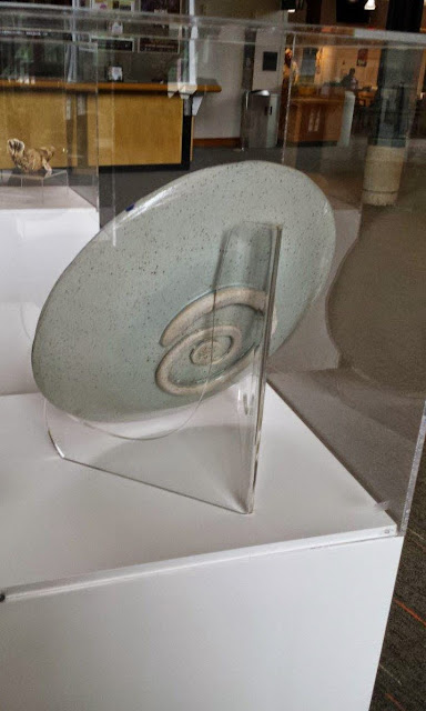 Back of stoneware platter by Lily, on display at Shadbolt Center in Burnaby.