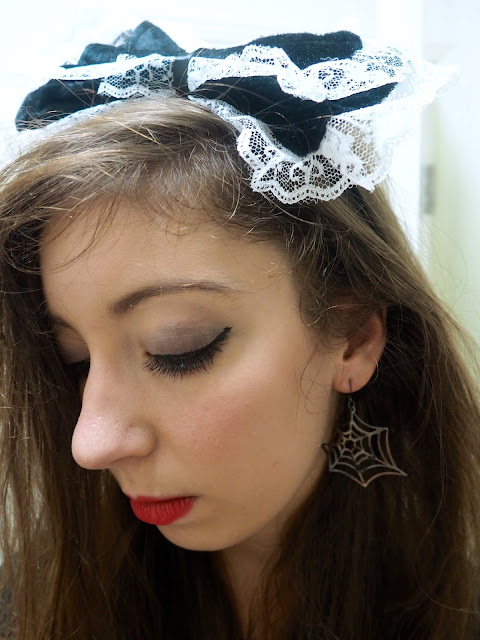 Fright Nights | maid fancy dress outfit details of black and white frilly bow headband and spider web earring