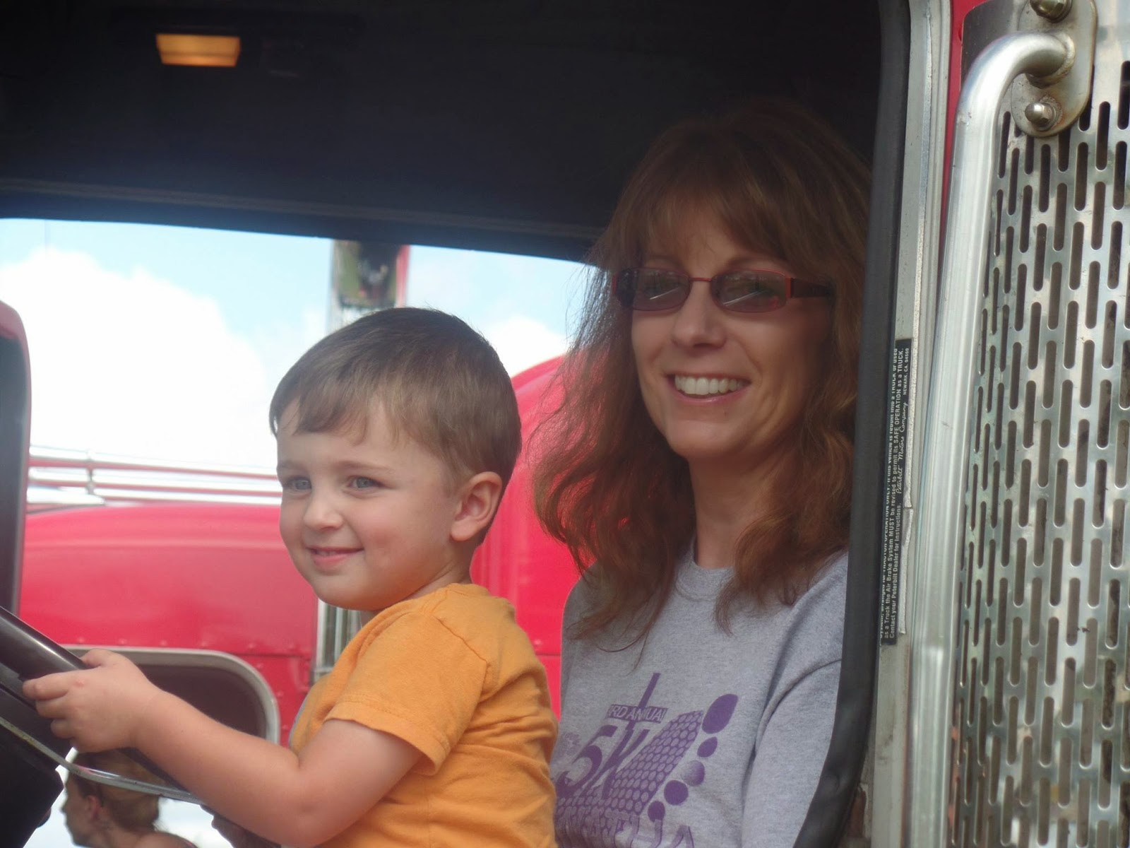 my mom and son in a truck