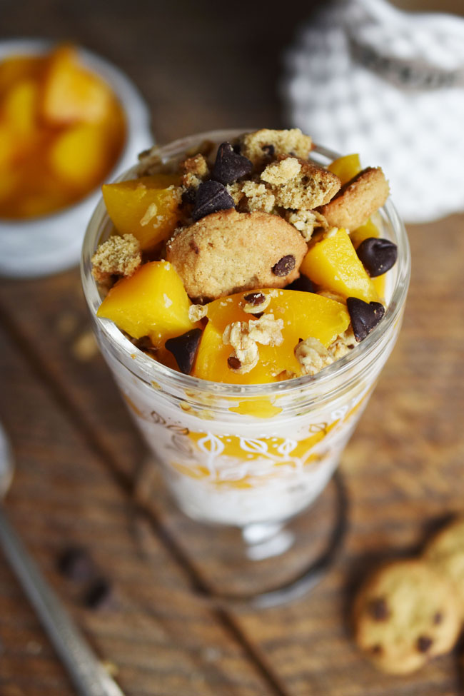 This dessert parfait features a base of cultured coconut (aka coconut yogurt) mixed with semi-sweet chocolate chips and a bit of maple syrup for sweetness. Layering this yogurt mixture with naturally sweet and healthy California cling peaches and crunchy granola makes for a satisfying taste sensation that will have you forgetting about rich, fatty desserts. #vegan #glutenfree #healthy