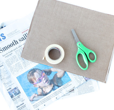 Paper Table Challenge: 8 sheets of newspaper and tape: must hold a book
