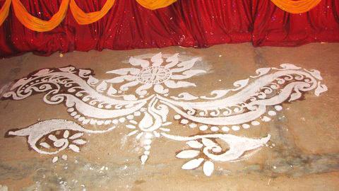 alpona wedding snaps On floor alpona
