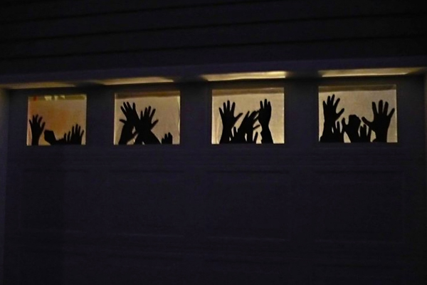 if you have windows in your garage this will be the perfect addition to add spookiness to your halloween decor find the full tutorial at the wisteria - Outdoor Halloween Decor