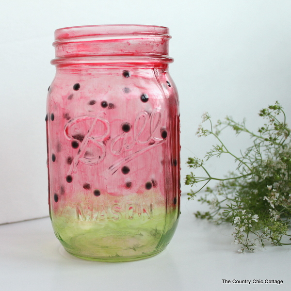 Watermelon Mason Jar -- learn how to paint a great watermelon mason jar craft for summer.  Perfect for decorating your home or for parties.  The jar turns out see through so you can add candles easily.