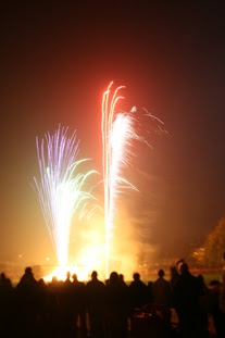 fireworks, bonfire, dark sky, people watching the fireworks