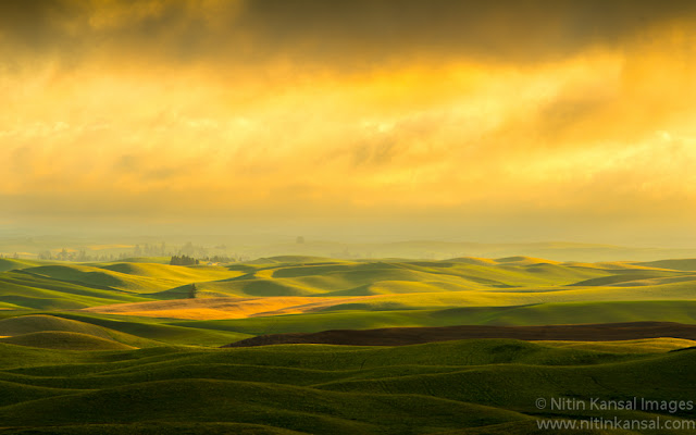 Stormy Sunset light over rolling hills