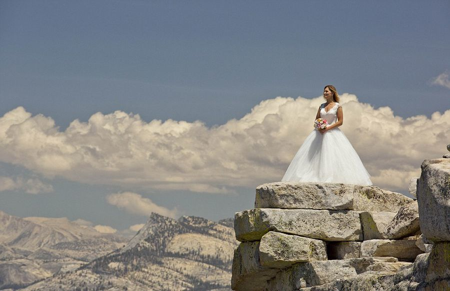 One thousand meters cliff climb couple wedding photographs