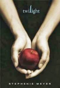 Cover art for Twilight by Stephenie Meyer, featuring a white person's hands cupping an apple against a black background
