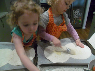 Preparing the tortillas for the tostadas