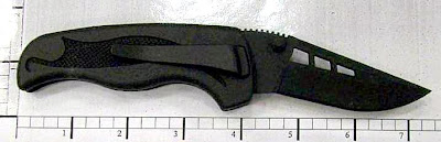 Folding plastic knife discovered at Salt Lake City.