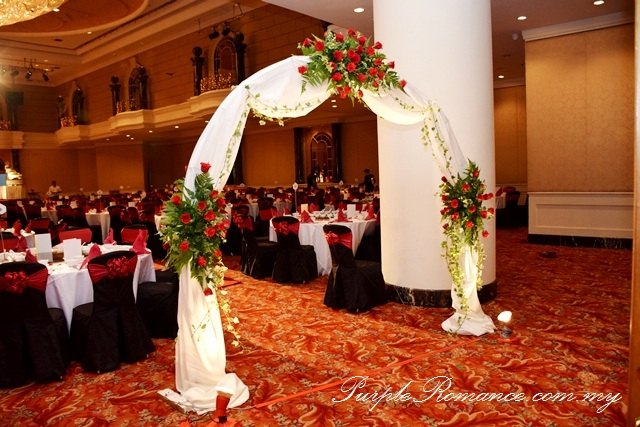 Red Black Lace Wedding Decoration at Renaissance Hotel Kuala Lumpur, petals, floating candle, walkway, aisle, flower stand, floral, red roses, ballroom, selangor, malaysia, elegant, vibrant, special, unique, wedding day, VIP table centerpiece, block candle, posie, chair tie back, maroon, entrance flower arch