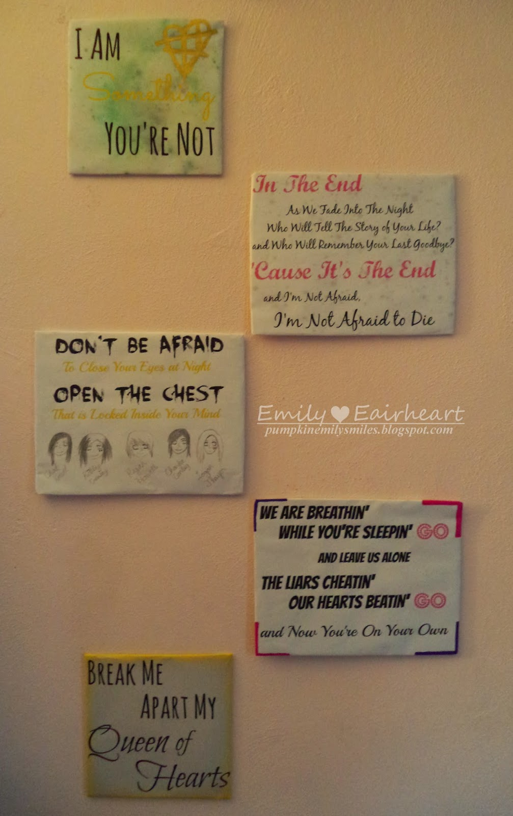 The layout of the lyric art on the wall.