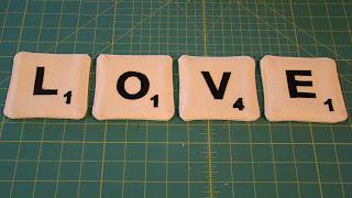 http://www.lorihartmandesigns.com/2011/12/scrabble-coaster-tutorial.html