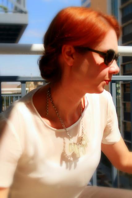 chiffon t-shirt, statement necklace, victory rolls