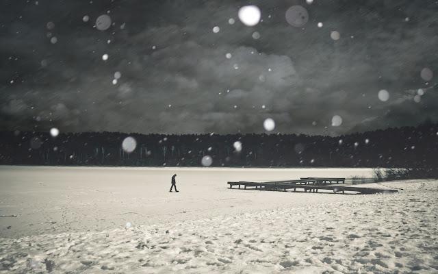 Man walking on Frozen Lake Snowflakes HD Wallpaper