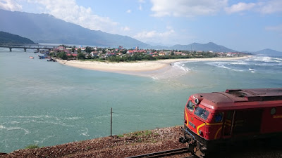A train passes by next to a small island enroute between Hoian and Hue, Vietnam
