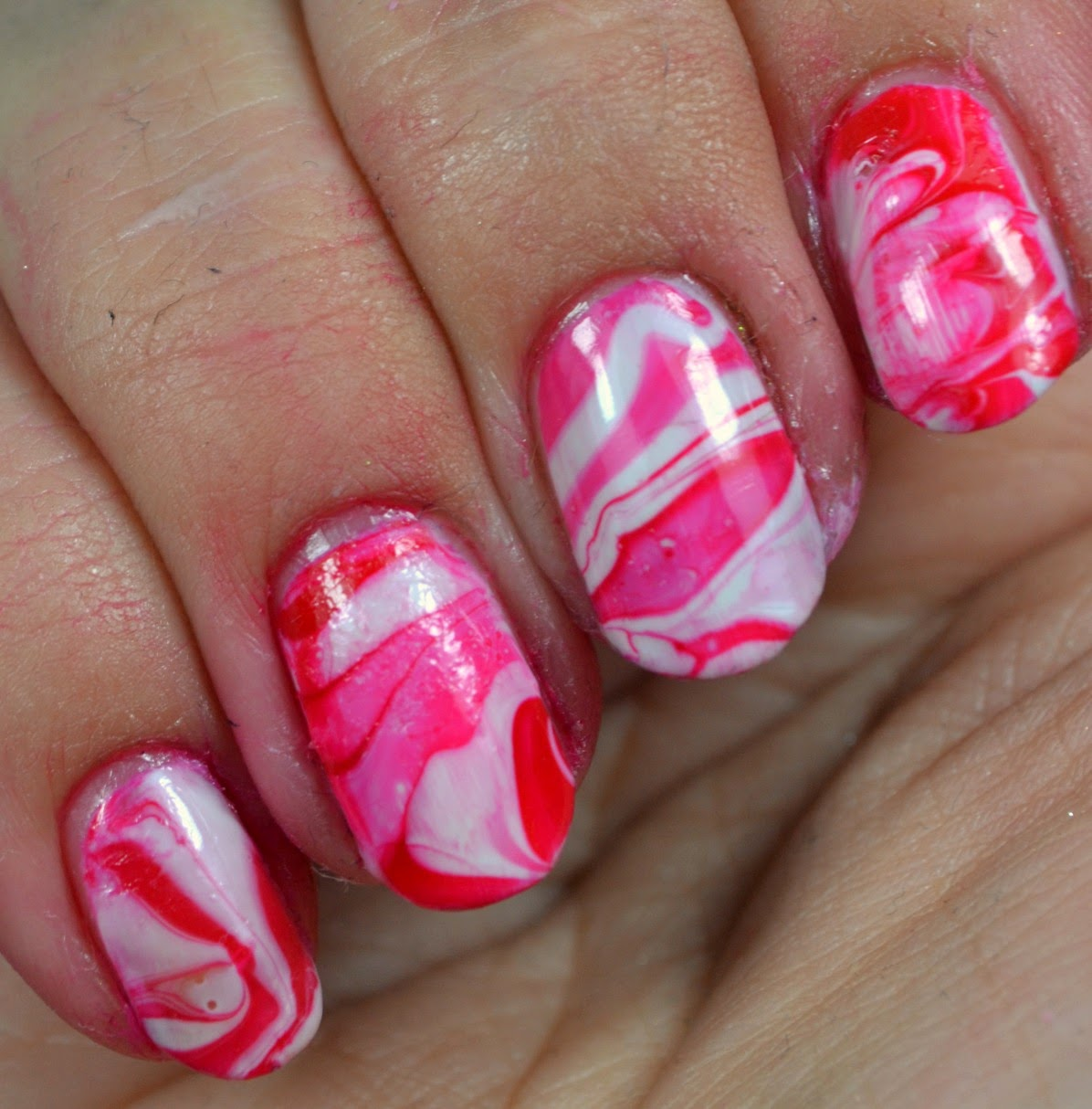 Beauty with a twist it started with hello i couldnt help being inspired and coming up with some super sweet nail art i decided to go with some water marbling since strawberry cheesecake usually solutioingenieria Images