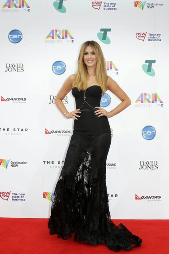 The Gothic queen has arrived! No one can say Delta Goodrem didn't go all out for the 28th Annual Aria Awards. Girlfriend might've been late, but the 30-year-old made a freaking statement in this floor length gown to the red carpet at Sydney, Australia on Wednesday, November 26, 2014.