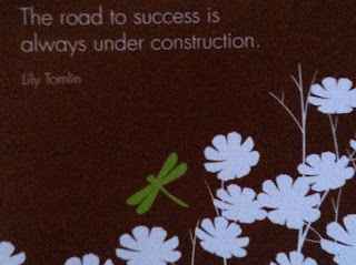 Lily Tomlin quote: Road to success is always under construction