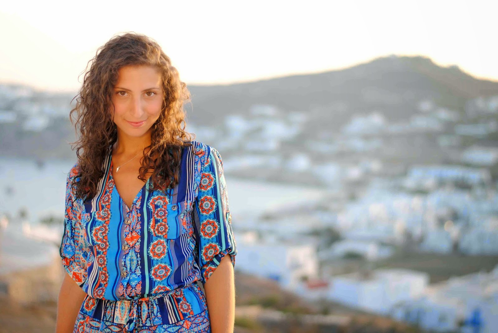 mykonos greece blue paisley romper ray ban clubmaster curly hair
