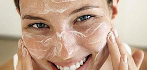 female washing face