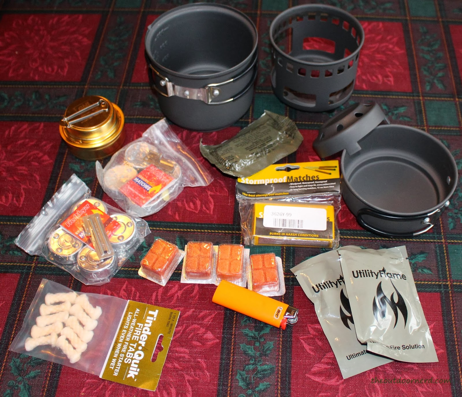 Esbit 5-Piece Trekking Cook Set - Shown with extra fuel, matches, lighter, can openers and tinder