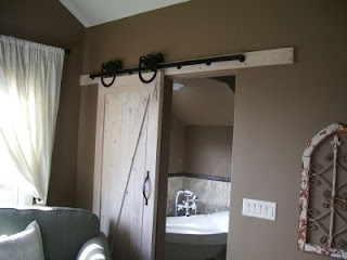 Photo of a interior barn door with sliding barn door hardware