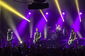 5 Seconds Of Summer in one of their performances.