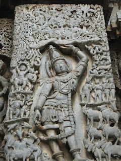 Krishna supporting mount Govardhana. Twelfth-century sculpture from the Temple of Kesava, Belur.