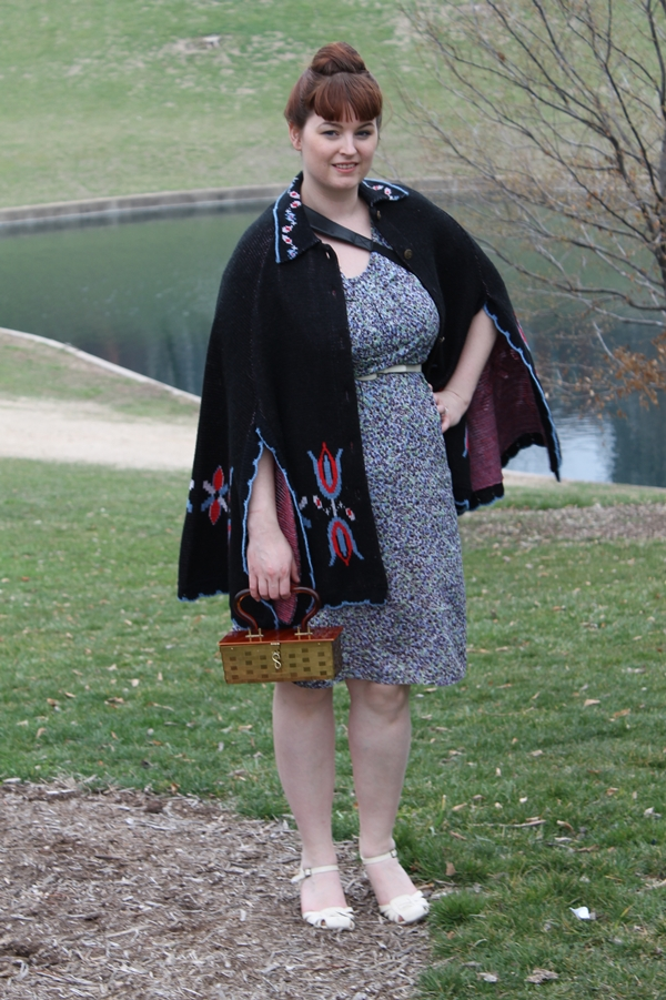 Brittany from Va Voom Vintage in 1960's dress with knitted cape, lucite handbag and beehive hair