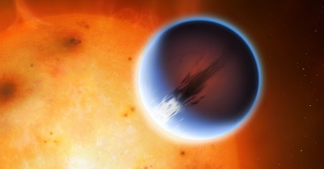 The planet HD 189733b is shown here in front of its parent star. A belt of wind around the equator of the planet travels at 5400mph from the heated day side to the night side. The day side of the planet appears blue due to scattering of light from silicate haze in the atmosphere. The night side of the planet glows a deep red due to its high temperature. Credit: Mark A. Garlick/University of Warwick