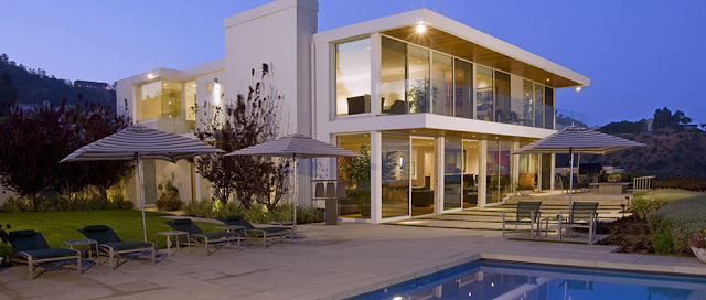 Picture of modern mansion as seen from the pool area