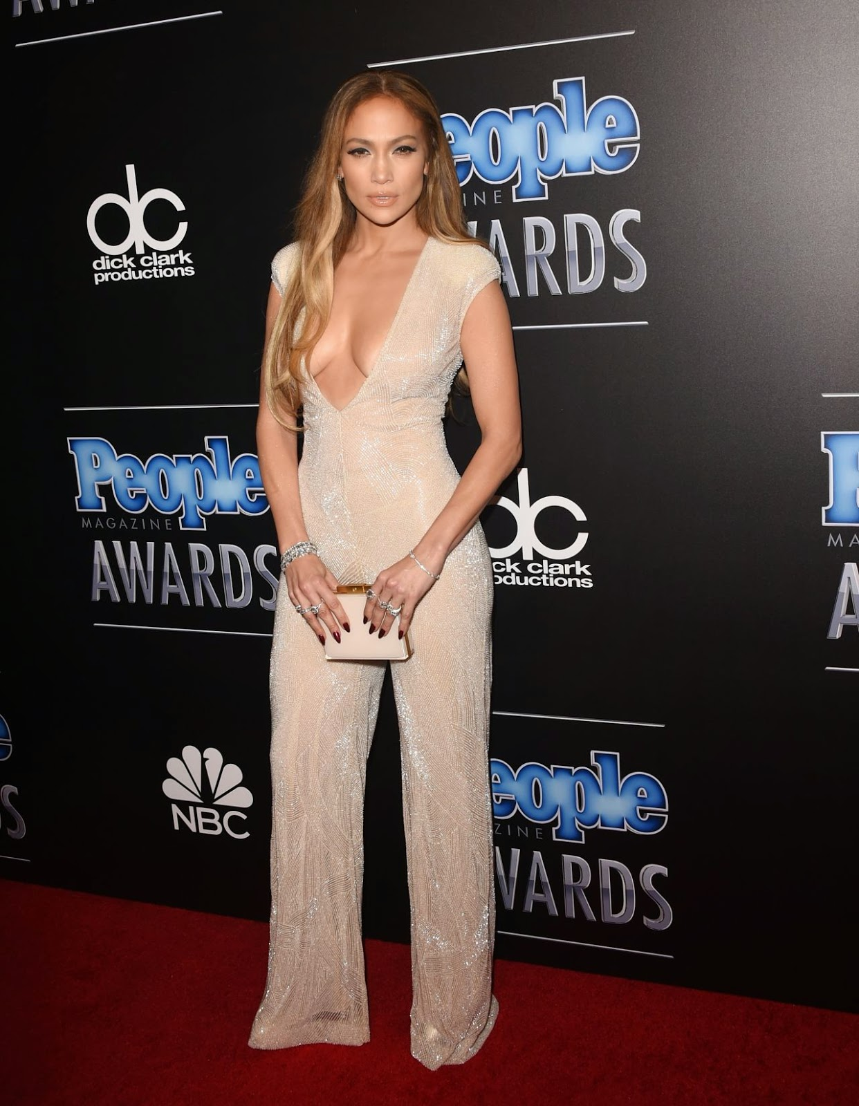 Jennifer Lopez wears a sexy plunging jumpsuit at the 2014 People Magazine Awards