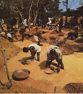 Panning gravels in the search for alluvial for alluvial diamonds on the banks of River Sewa in Sierra Leone.