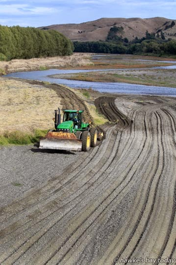 The rarely-seen gravel groomer operated by the Hawke's Bay Regional Council, working along the Tutaekuri River, pictured from the Hawke's Bay Expressway bridge, Napier. Like a snail, you can always tell where he's been. photograph